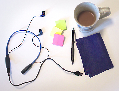 Coffee, headphones and other teaching supplies on a table