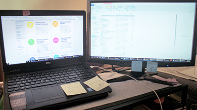 a laptop and a second screen connected to the same laptop